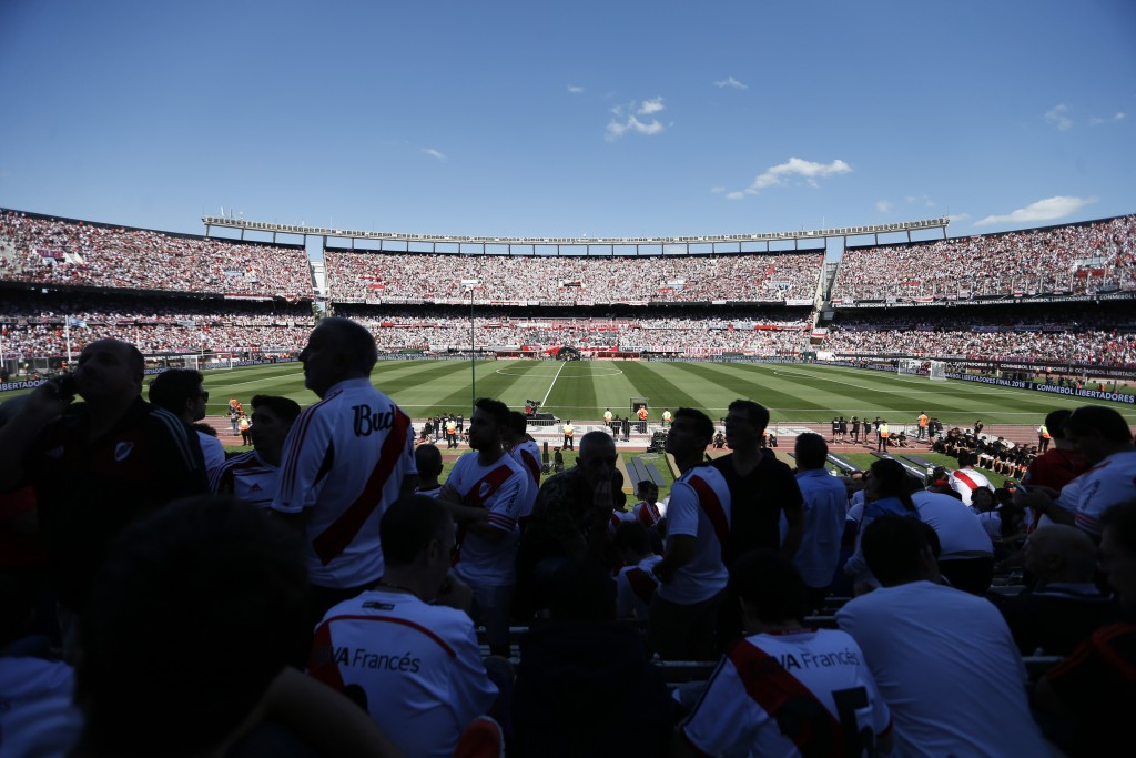 Fans of Argentina's River Plate wait for the final soccer match of the Copa Libertadores against Argentina's Boca Juniors at the Antonio Vespucio Libe...