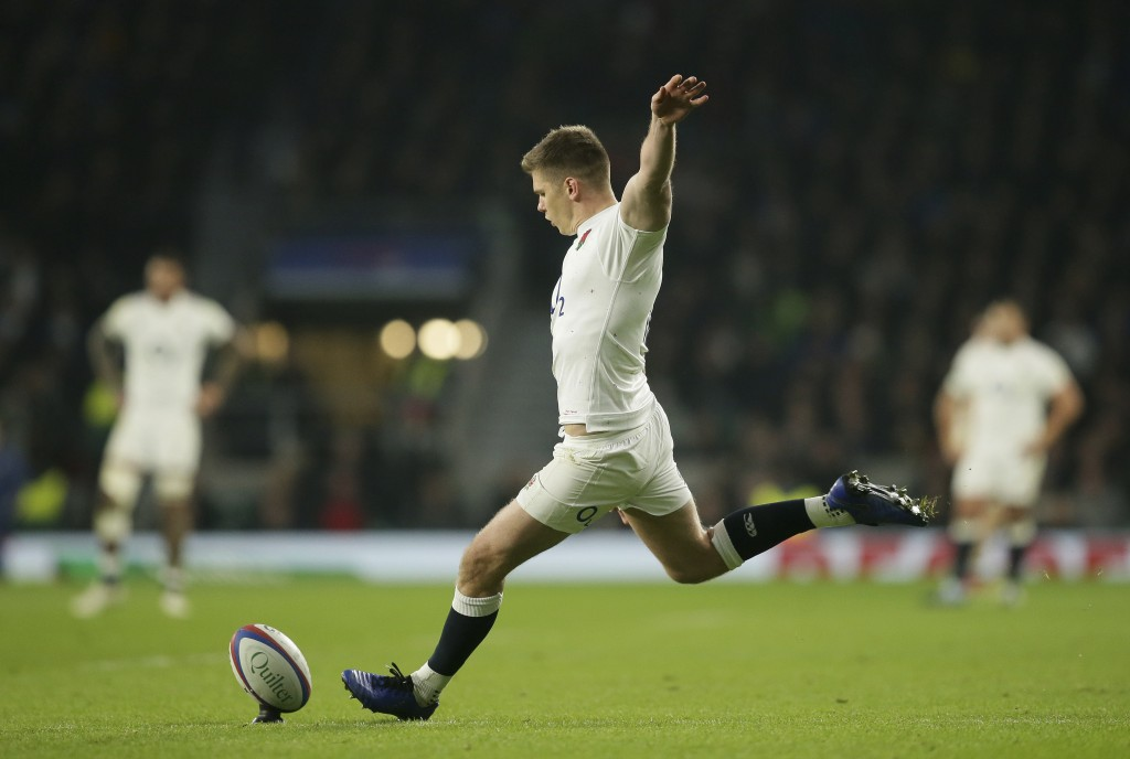 England's Owen Farrell kicks a conversion during the rugby union international between England and Australia at Twickenham in London, Saturday, Nov. 2...