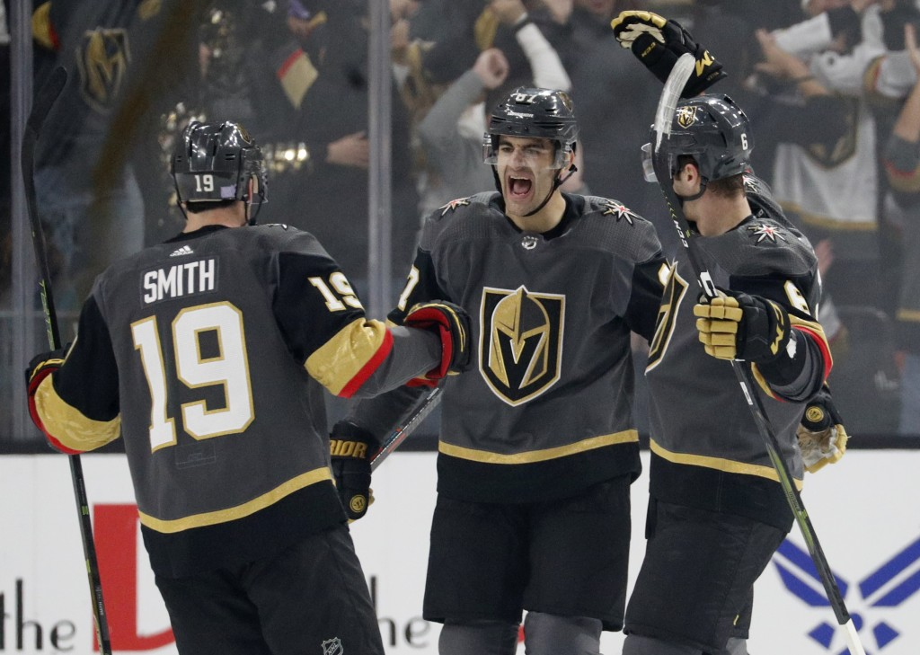 Vegas Golden Knights right wing Reilly Smith (19) and defenseman Colin Miller, right, celebrate after left wing Max Pacioretty, center, scored against