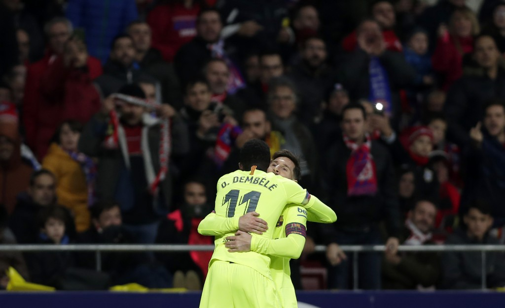 Barcelona's Ousmane Dembele, front, celebrates with Lionel Messi after scoring his side's opening goal during a Spanish La Liga soccer match between A...