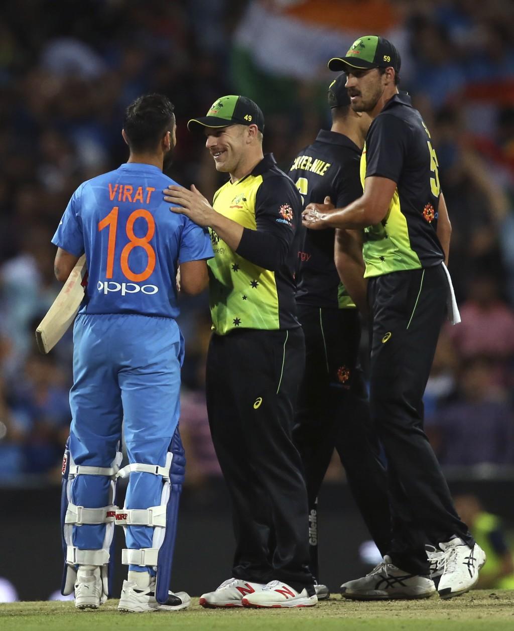 India's Virhat Kohli, left, is congratulated by Australia's captain Aaron Finch after winning their Twenty20 cricket match in Sydney, Sunday, Nov. 25,
