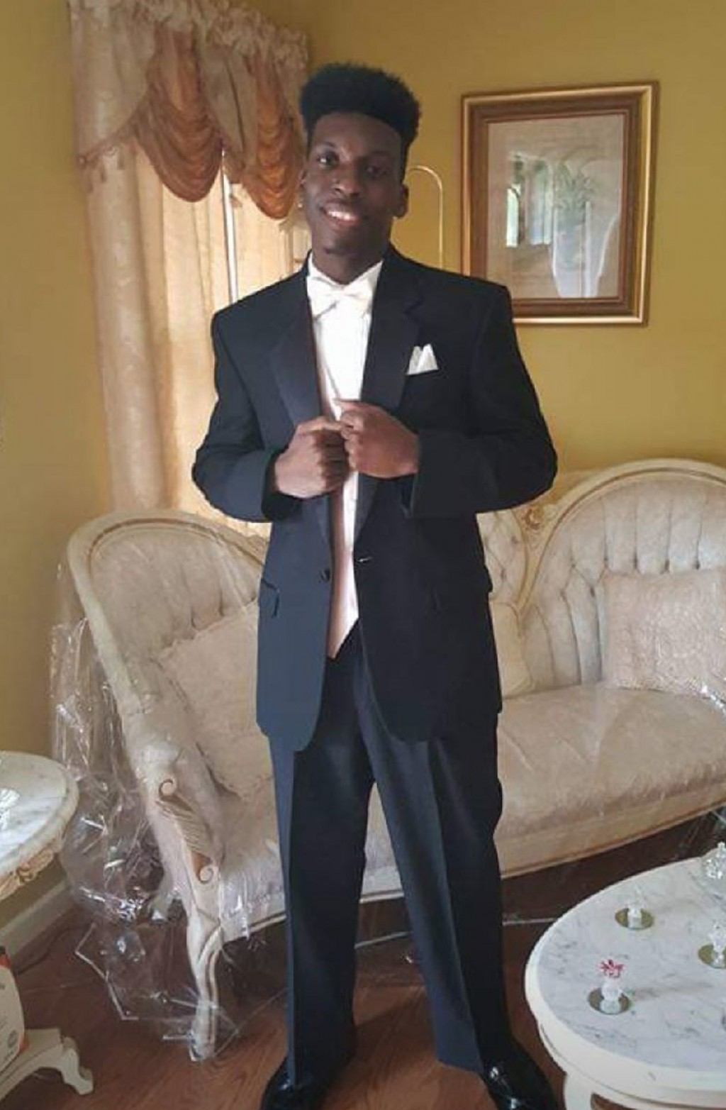 This undated image provided by Emantic Bradford, Sr. shows Emantic Fitzgerald Bradford, Jr., 21, posing for a picture at his father's home near Birmin...