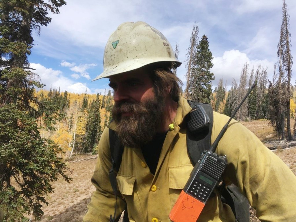In this 2018 photo provided by Christopher Schott, Schott works in Utah with a firefighting crew out of Lakeview, Ore. After being in firefights in Af...