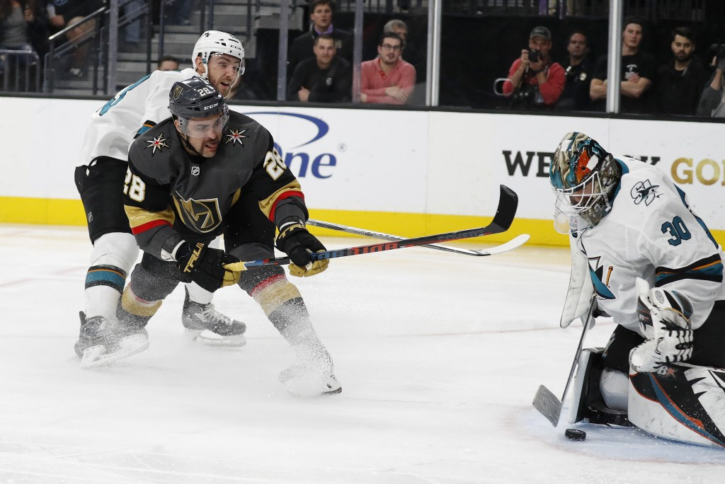 Vegas Golden Knights left wing William Carrier (28) scores on San Jose Sharks goaltender Aaron Dell (30) during the second period of an NHL hockey gam...