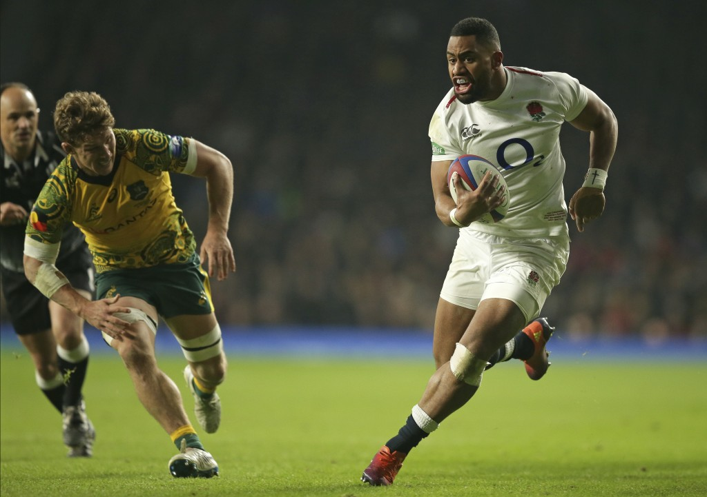 England's Joe Cokanasiga runs in to score a try during the rugby union international between England and Australia at Twickenham in London, Saturday,