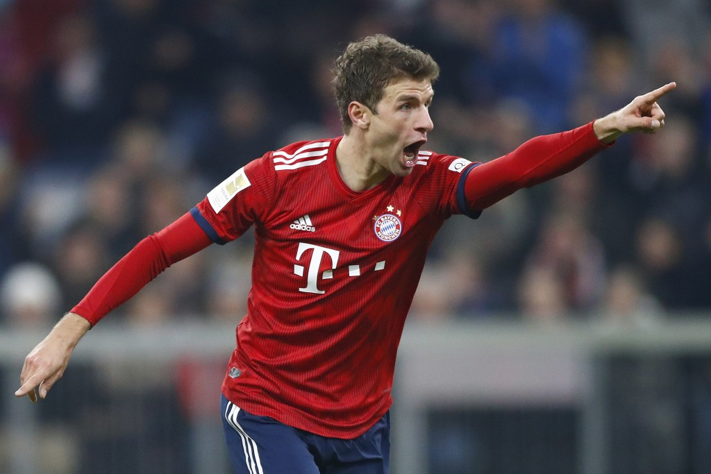 Bayern's Thomas Mueller celebrates after scoring his side's third goal during the German Bundesliga soccer match between FC Bayern Munich and Fortuna