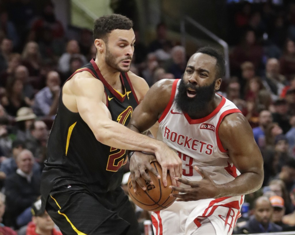 Cleveland Cavaliers' Larry Nance Jr. (22) knocks the ball loose from Houston Rockets' James Harden (13) in the second half of an NBA basketball game, ...