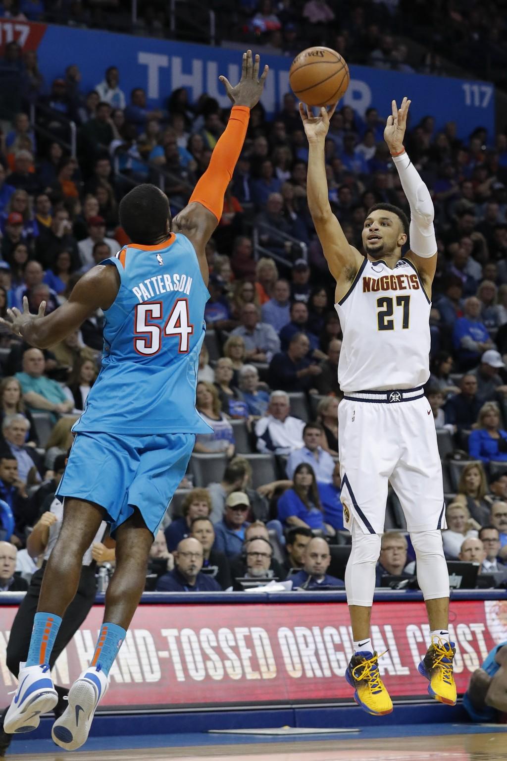 Denver Nuggets guard Jamal Murray (27) shoot as Oklahoma City Thunder forward Patrick Patterson (54) defends during the first half of an NBA basketbal...