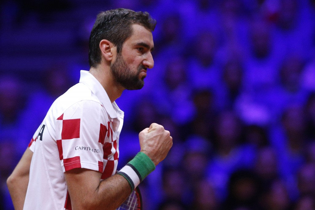 Croatia's Marin Cilic clenches his fist as he wins the first set against France's Lucas Pouille during the Davis Cup final between France and Croatia