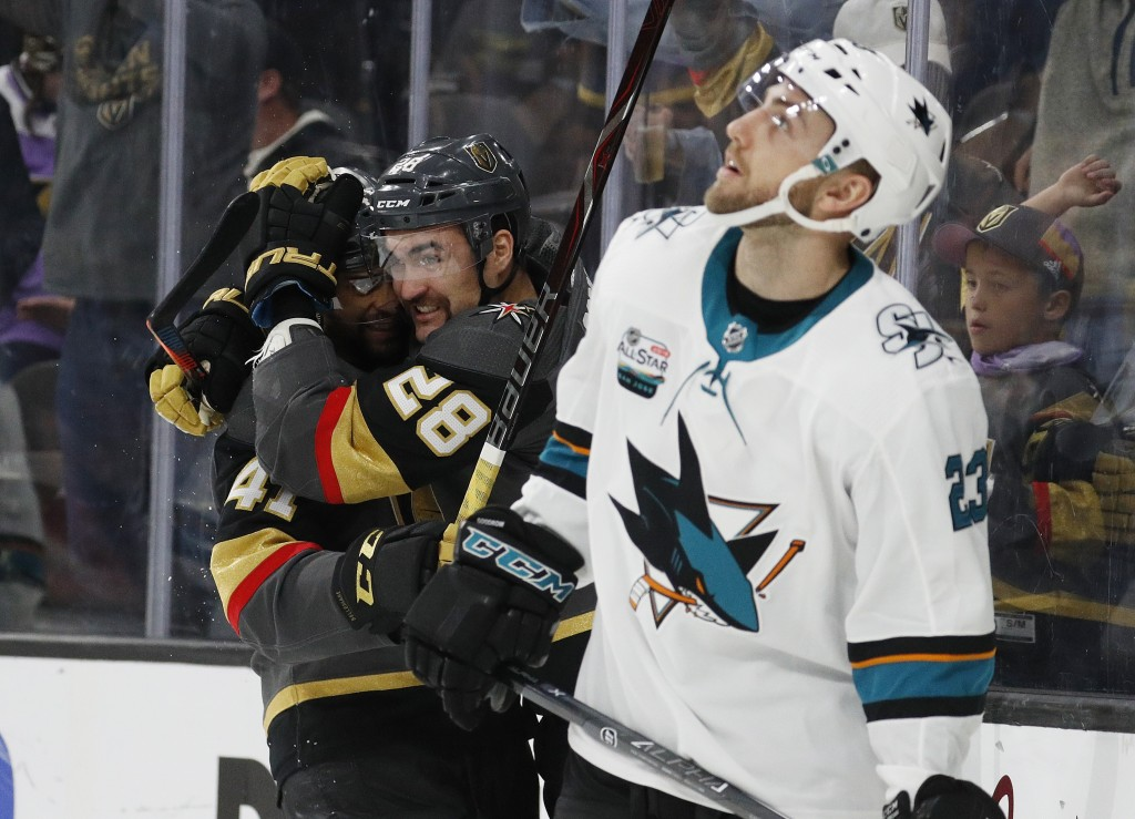 Vegas Golden Knights center Pierre-Edouard Bellemare, celebrates after left wing William Carrier (28) scored against the San Jose Sharks during the se...