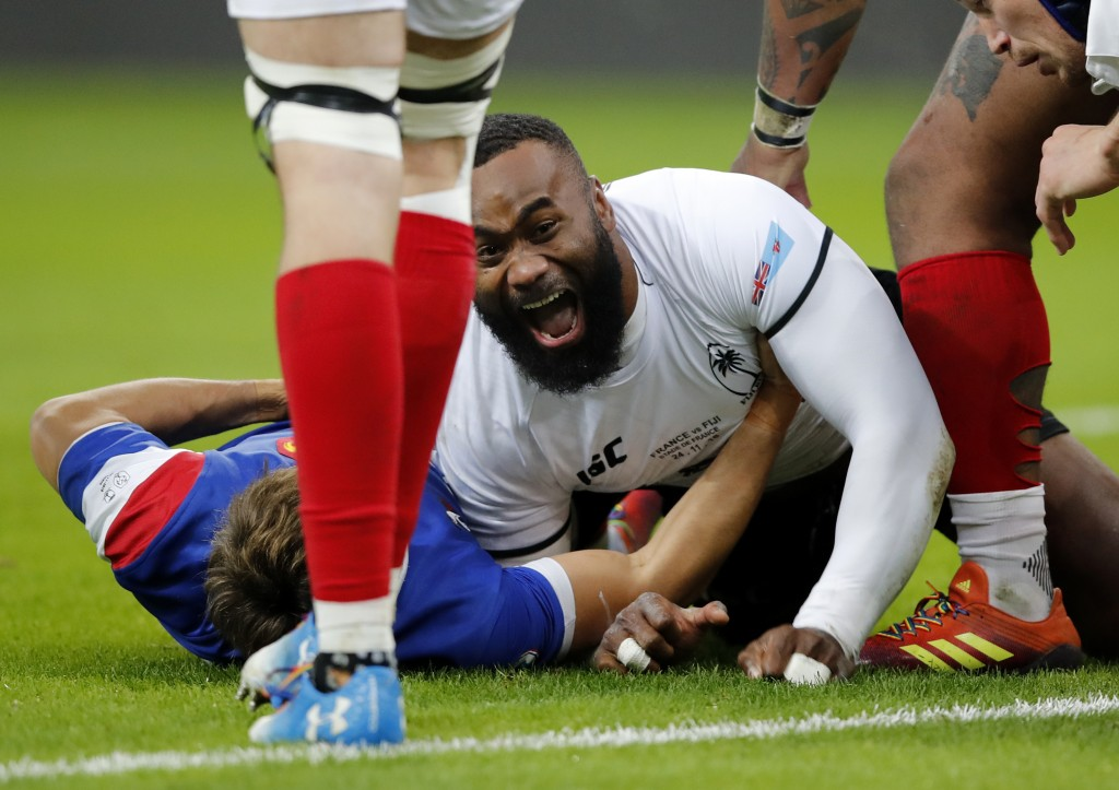 Fiji's Semi Radradra celebrates after scoring a try against France during the rugby international between France and Fiji at Stade de France in Paris,...