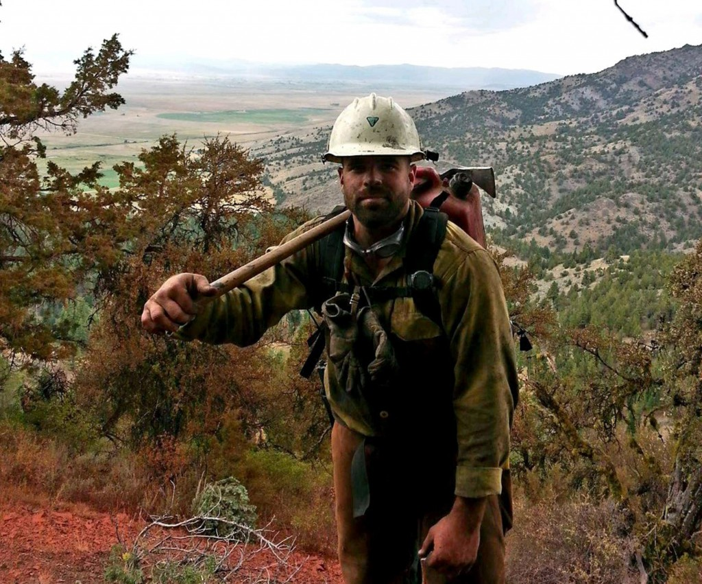 This 2014 photo provided by Christopher Schott shows him during his first year on a firefighting crew out of Lakeview, Ore. Schott served two tours in...