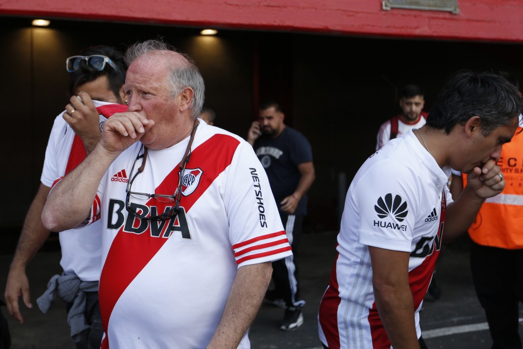 River Plate fans affected by pepper gas enter to Antonio Vespucio Liberti stadium prior to the final soccer match of the Copa Libertadores in Buenos A