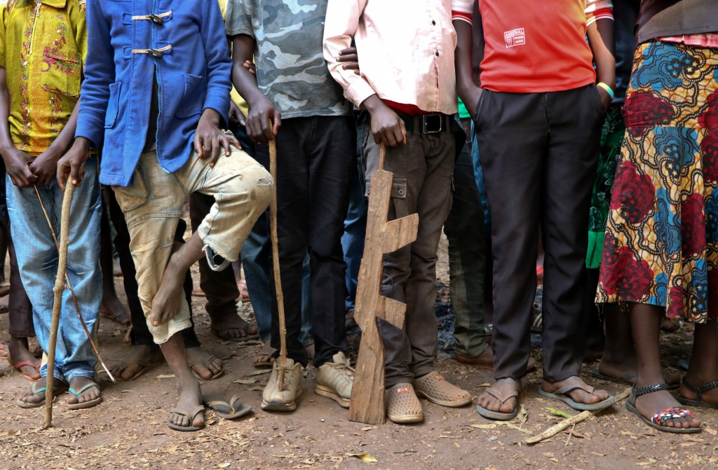FILE - In this Wednesday, Feb. 7, 2018 file photo, former child soldiers stand in line waiting to be registered with UNICEF to receive a release packa...