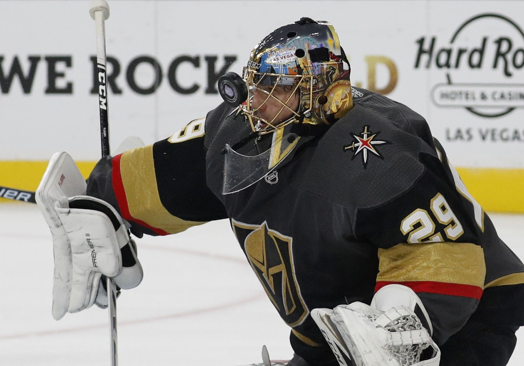 Vegas Golden Knights goaltender Marc-Andre Fleury makes a save against the San Jose Sharks during the first period of an NHL hockey game Saturday, Nov...