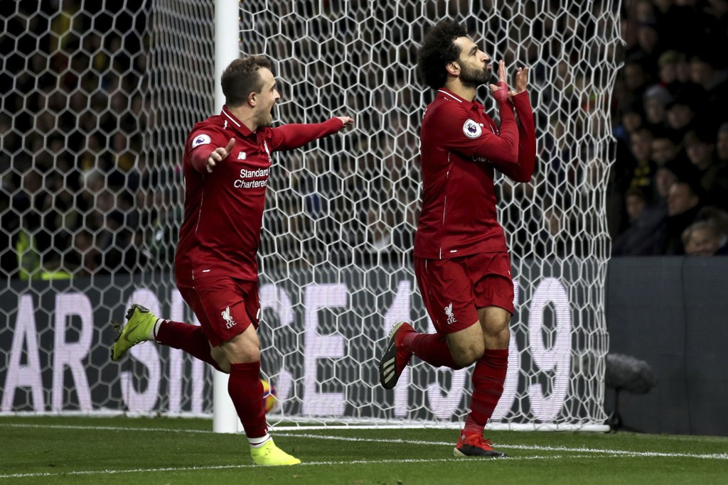 Liverpool's Mohamed Salah, right, celebrates scoring his side's first goal of the game with team mate Xherdan Shaqiri during their English Premier Lea