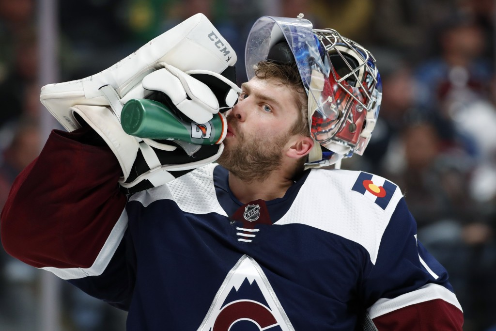 Colorado Avalanche goaltender Semyon Varlamov drinks during a timeout in the second period of an NHL hockey game against the Dallas Stars, Saturday, N
