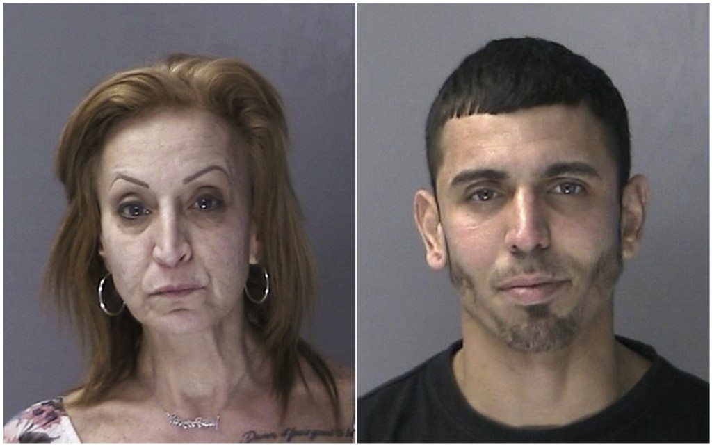 In this combination of two Nov. 22, 2018 booking photos provided by the Suffolk County Police Department in Yaphank, N.Y., Angela Reilly and Carlos Ga...