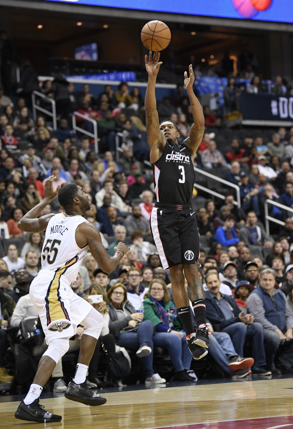 Washington Wizards guard Bradley Beal (3) shoots over New Orleans Pelicans guard E'Twaun Moore (55) during the second half of an NBA basketball game S...