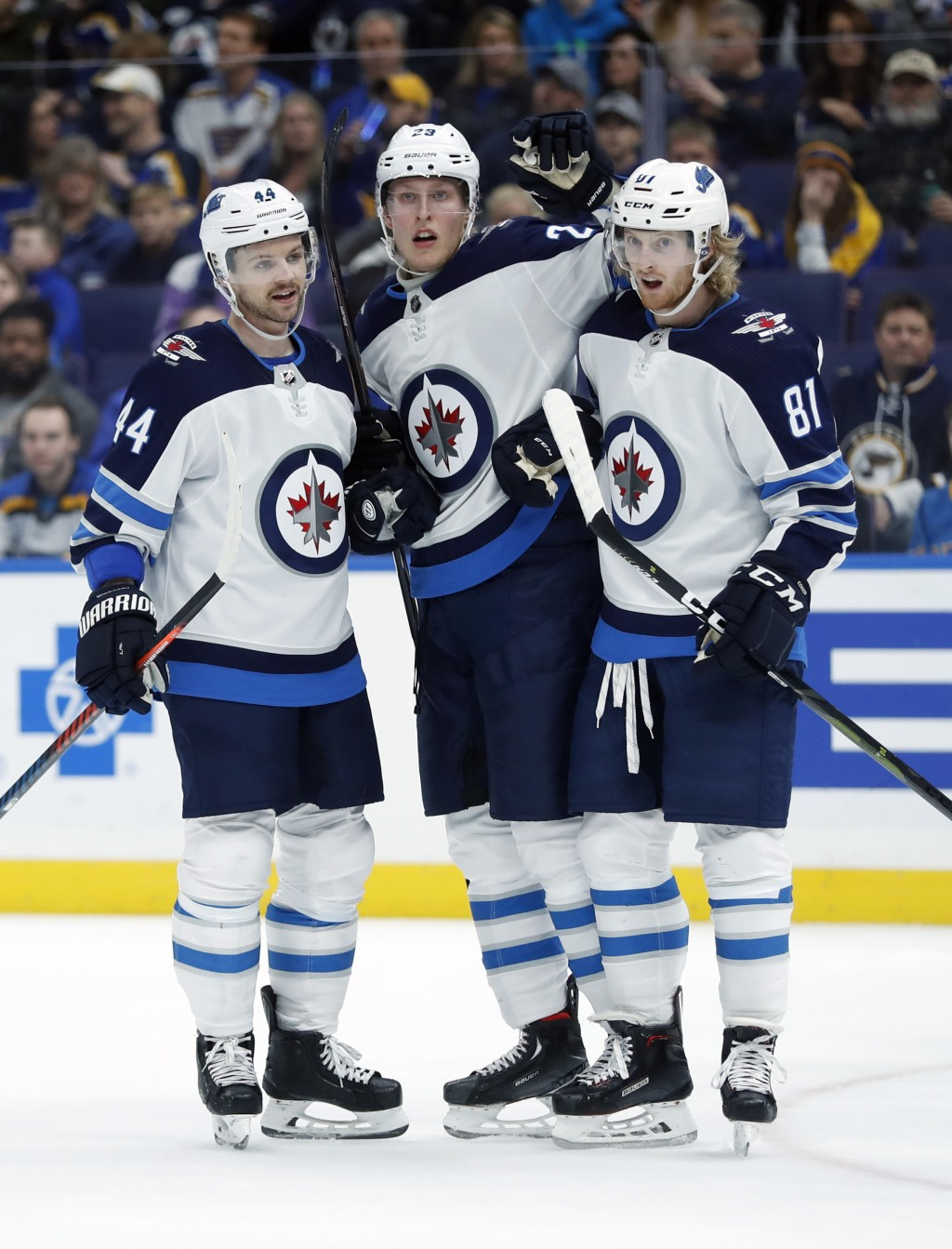 Winnipeg Jets' Patrik Laine, of Finland, is congratulated by Josh Morrissey (44) and Kyle Connor (81) after scoring during the first period of an NHL