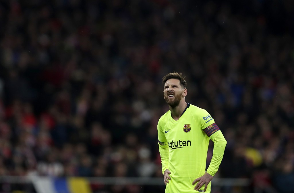 Barcelona's Lionel Messi reacts during a Spanish La Liga soccer match between Atletico Madrid and FC Barcelona at the Metropolitano stadium in Madrid,...