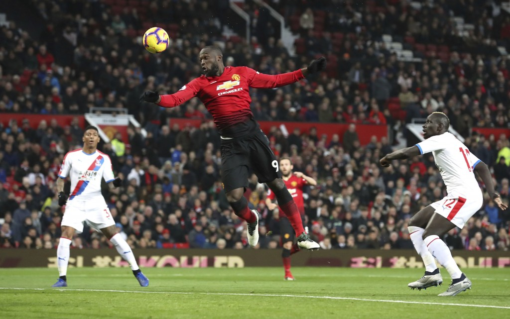 Manchester United's Romelu Lukaku shoots towards goal during their English Premier League soccer match against Crystal Palace at Old Trafford, Manches