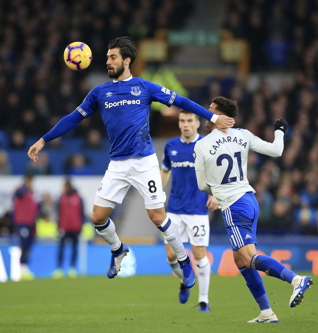 Everton's Andre Gomes, left, and Cardiff City's Victor Camarasa vie for the ball during a Premier League soccer match between Everton and Cardiff, at