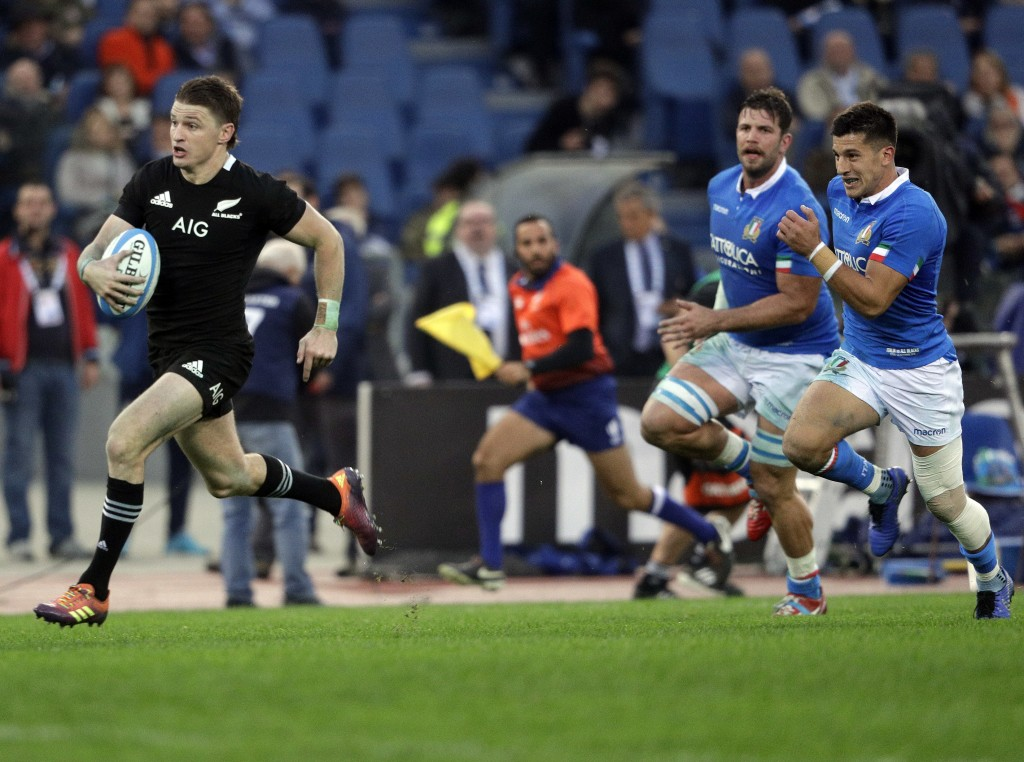 New Zealand's Beauden Barrett runs on his way to score a try during the rugby union international match between Italy and New Zealand at the Olympic S