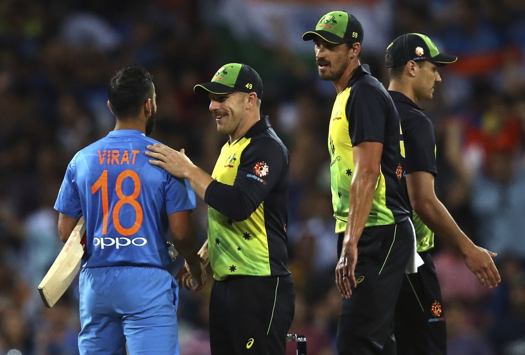 India's Virhat Kohli, left, is congratulated by Australia's captain Aaron Finch after winning their Twenty20 cricket match in Sydney, Sunday, Nov. 25,...