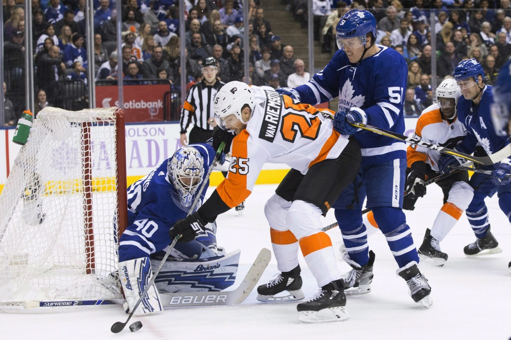 Philadelphia Flyers' James van Riemsdyk (25) tries to get puck past Toronto Maple Leafs goaltender Garret Sparks during the second period of an NHL ho