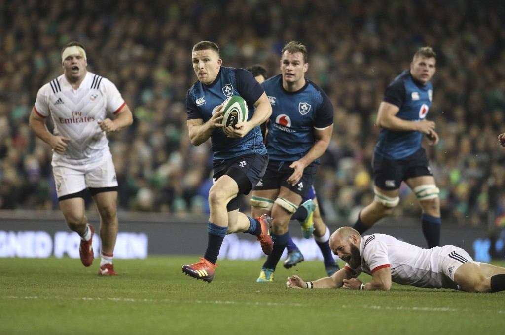 Ireland's Andrew Conway breaks through despite being tackled by USA's Shaun Davies during their Rugby Union International at the Aviva Stadium, Dublin...