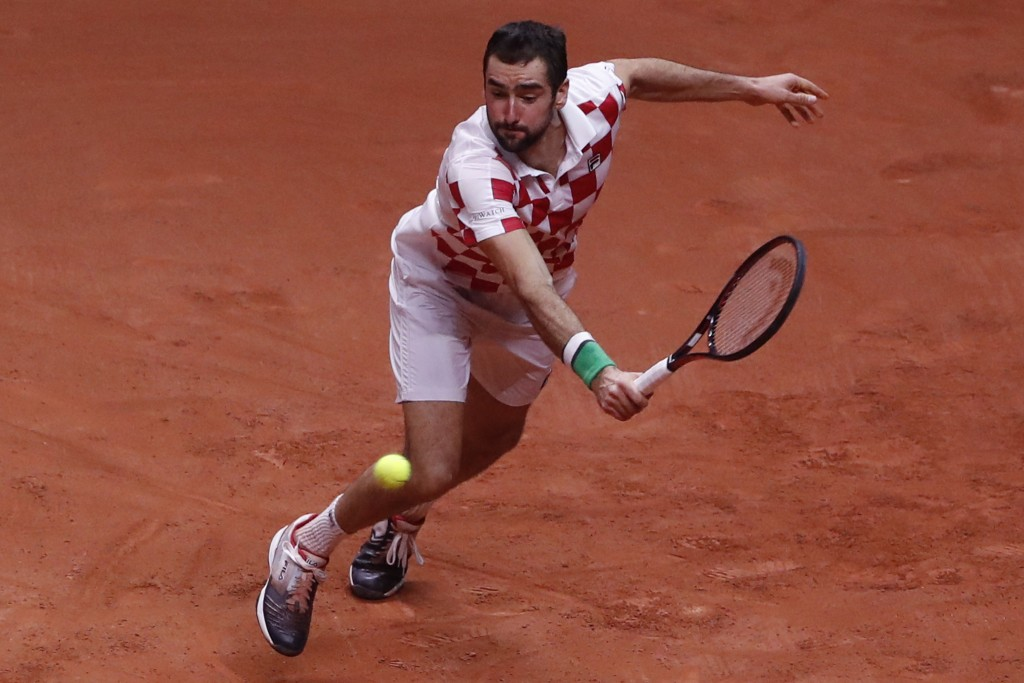 Croatia's Marin Cilic returns the ball to France's Lucas Pouille during the Davis Cup final between France and Croatia Sunday, Nov. 25, 2018 in Lille,