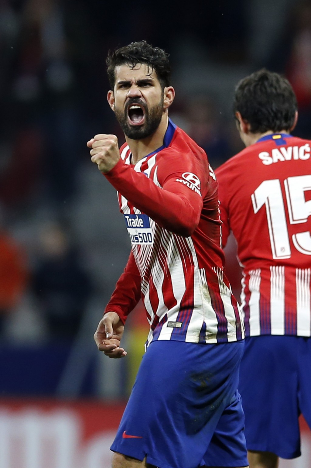 Atletico's Diego Costa celebrates after scoring the opening goal during a Spanish La Liga soccer match between Atletico Madrid and FC Barcelona at the