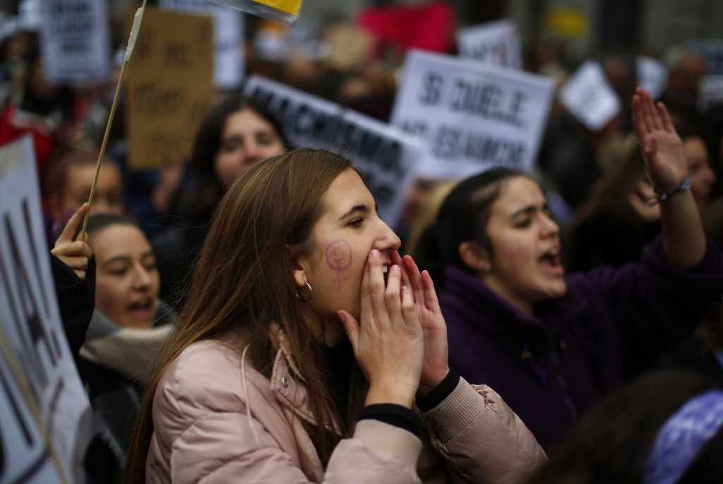 People take part during a protest against sexism and gender violence in Madrid, Spain, Sunday, Nov. 25, 2018. More than 40 marches are being held acro...