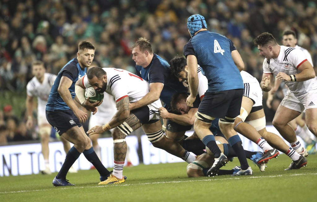 USA's Samu Manoa, left, is tackled by Ireland's Rhys Ruddock during their Rugby Union International at the Aviva Stadium, Dublin, Ireland, Saturday, N...