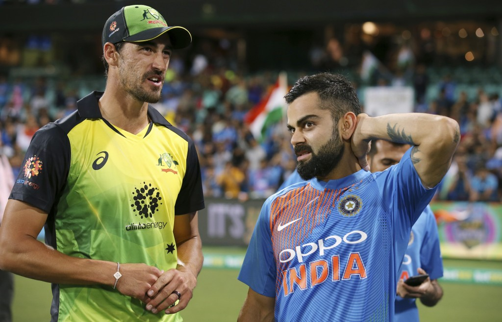India's Virhat Kohli, right, and Australia's Mitchell Starc chat following their Twenty20 cricket match in Sydney, Sunday, Nov. 25, 2018. India won th...