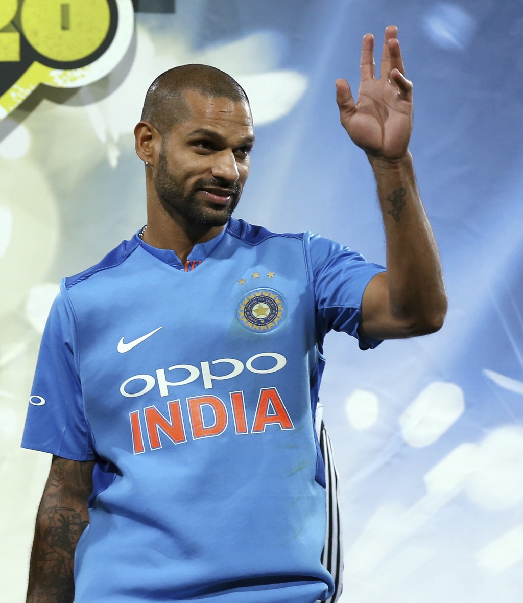 India's Shikhar Dhawan waves after being named man of the series after their Twenty20 cricket match against Australia in Sydney, Sunday, Nov. 25, 2018...