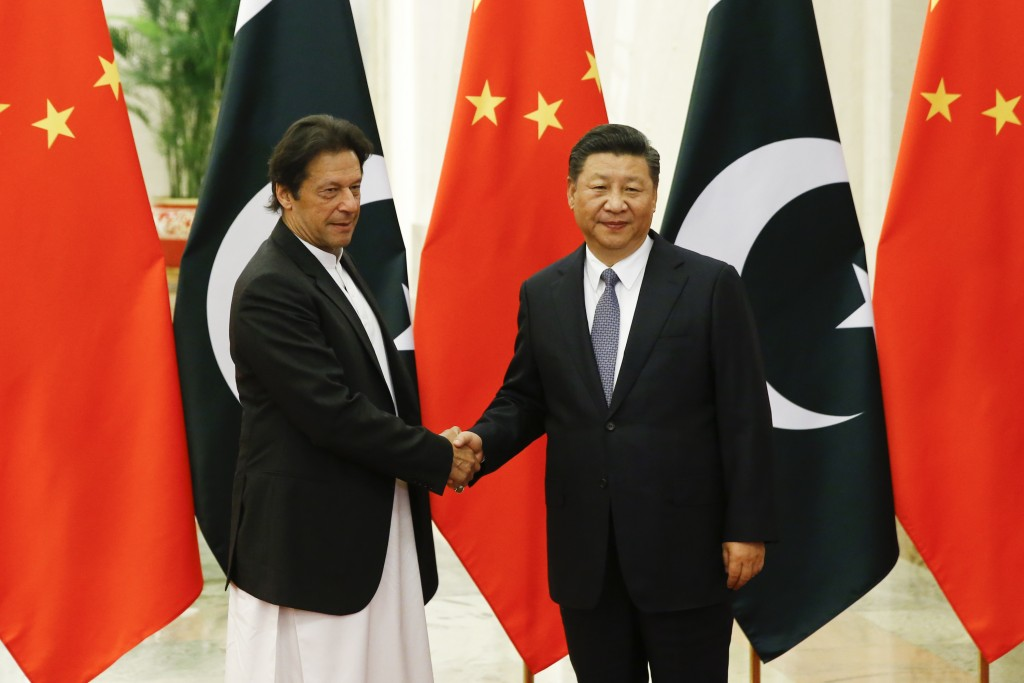 FILE - In this Friday, Nov. 2, 2018 file photo, Chinese President Xi Jinping meets Pakistani Prime Minister Imran Khan at the Great Hall of the People...