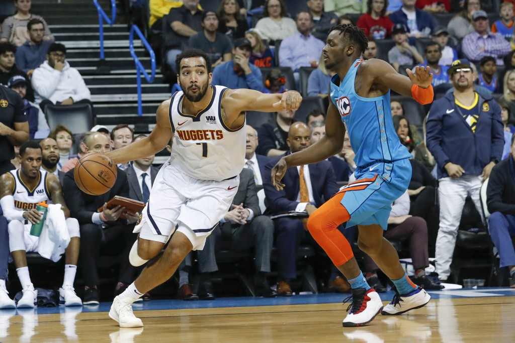 Denver Nuggets forward Trey Lyles (7) drives to the basket around Oklahoma City Thunder forward Jerami Grant (9) during the first half of an NBA baske...