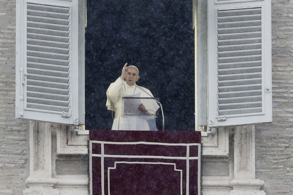 Pope Francis delivers a blessing from his studio window overlooking St.Peter's Square on the occasion of the Angelus noon prayer, at the Vatican, Sund