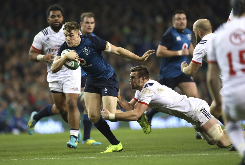 Ireland's Garry Ringrose, left, is tackled by USA's Cam Dolan during their Rugby Union International at the Aviva Stadium, Dublin, Ireland, Saturday, ...