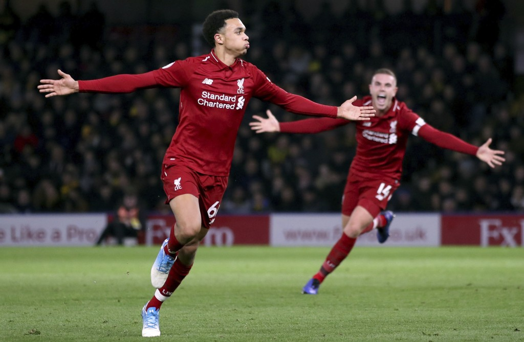 Liverpool's Trent Alexander-Arnold, left, celebrates scoring his side's second goal of the game with a free kickduring their English Premier League so