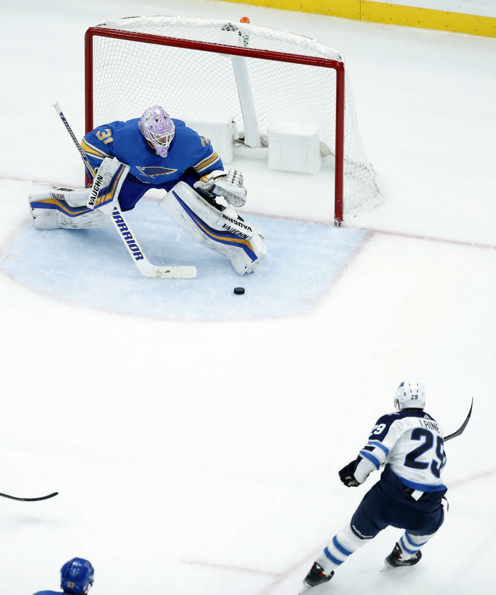 Winnipeg Jets' Patrik Laine (29), of Finland, scores against St. Louis Blues goaltender Chad Johnson during the second period of an NHL hockey game Sa...