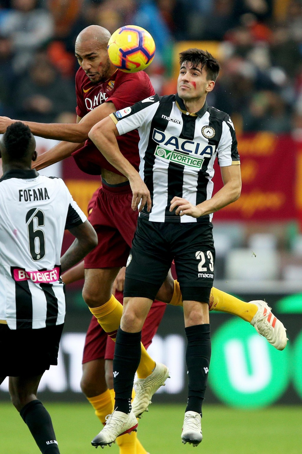 Udinese's Ignacio Pussetto, right, and Roma's Steven Nzonzi  jump for the ball during the Serie A soccer match between Udinese and Roma at the Friuli
