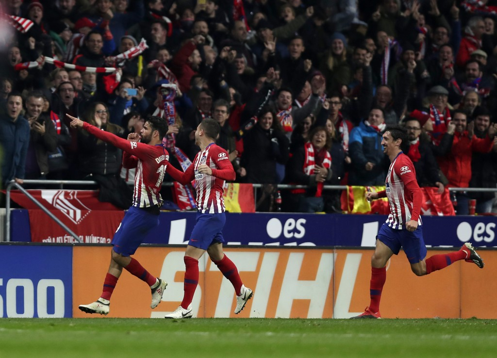 Athletico Madrid's Diego Costa, left, celebrates with teammates after scoring his side's opening goal during a Spanish La Liga soccer match between At...