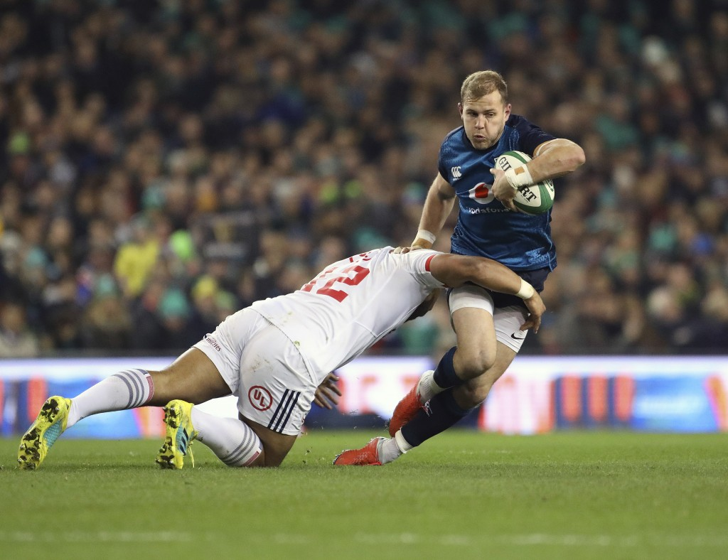 Ireland's Will Addison, right, is tackled by USA's Paul Lasike during their Rugby Union International at the Aviva Stadium, Dublin, Ireland, Saturday,...