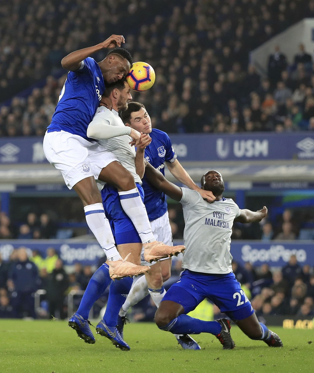 Everton's Yerry Mina, left, and Michael Keane, second from right, vie for the bal with Cardiff City's Sean Morrison, second from left, and Bruno Ecuel...