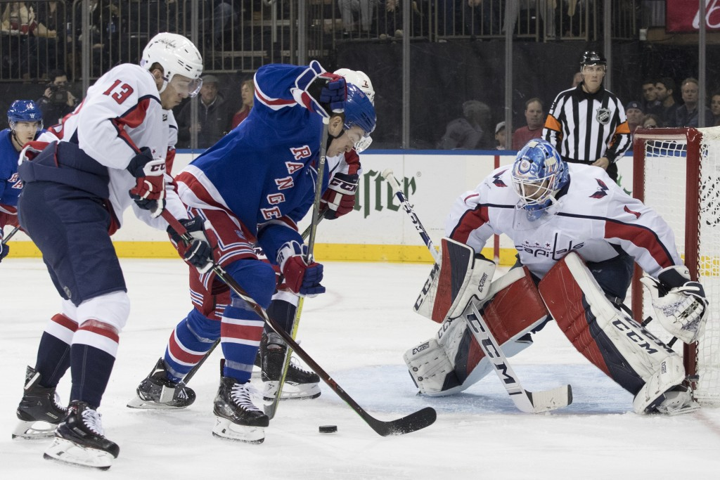 Washington Capitals left wing Jakub Vrana (13) and goaltender Pheonix Copley (1) tends the net against New York Rangers left wing Jimmy Vesey (26) dur