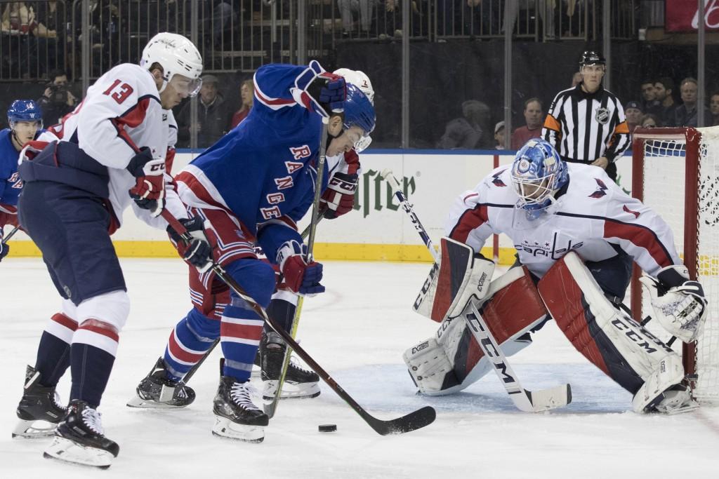 Washington Capitals left wing Jakub Vrana (13) and goaltender Pheonix Copley (1) tends the net against New York Rangers left wing Jimmy Vesey (26) dur...