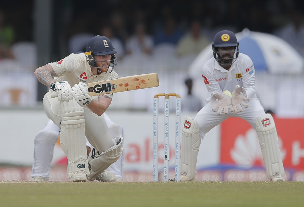 England's Ben Stokes plays a shot as Sri Lanka's wicketkeeper Niroshan Dickwella watches during the third day of the third test cricket match between